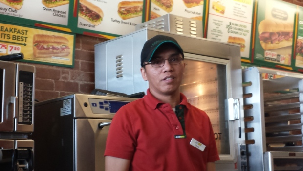 David Gutierrez supports his family in the Philippines with his Subway salary. (CBC)