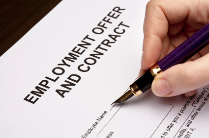 woman filling employment offer document