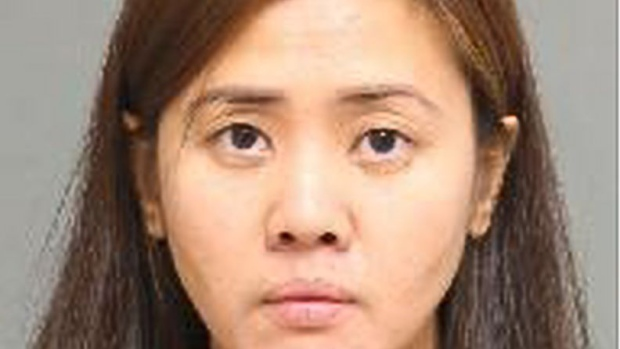 Lorna Natalie Arcega, 38, is shown in a handout photo. Arcega is facing a combined 18 charges after she allegedly stole an estimated $150,000 from victims she had promised to provide with low-fare airplane tickets to the Philippines. (Toronto Police Service)