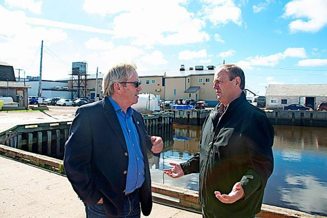 © Colin MacLean/TC Media Rodger Cuzner, left, Liberal candidate in Cape Breton-Canso chats with Egmont Liberal candidate Bobby Morrissey outside the Acadian Fisherman's Co-op in Abram Village on Oct. 5, 2015.