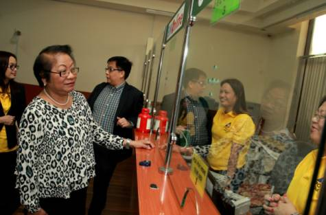 Rosalinda Baldoz, Philippine Labour Secretary, visits the labour office on December 4, 2014, where she is introduced to the recently launched skills programmes and improvements in facilities.