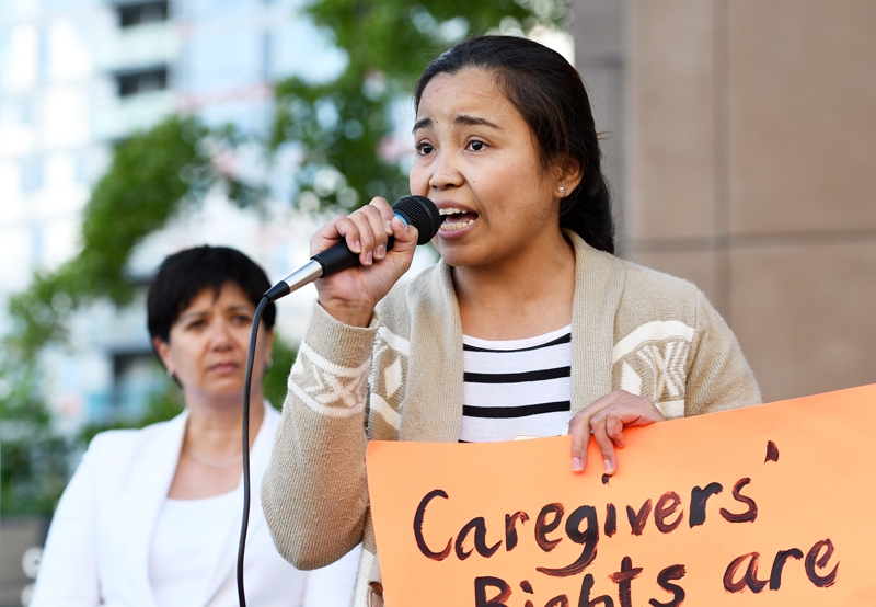 Former caregiver Hessed Torres speaks at a rally to mark International Domestic Workers Day on June 16, 2016.