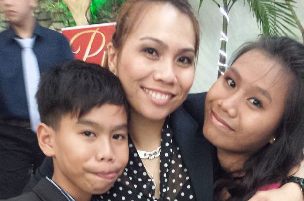 Jesapher Diaz Dumanjug is waiting to be reunited with her son and daughter.