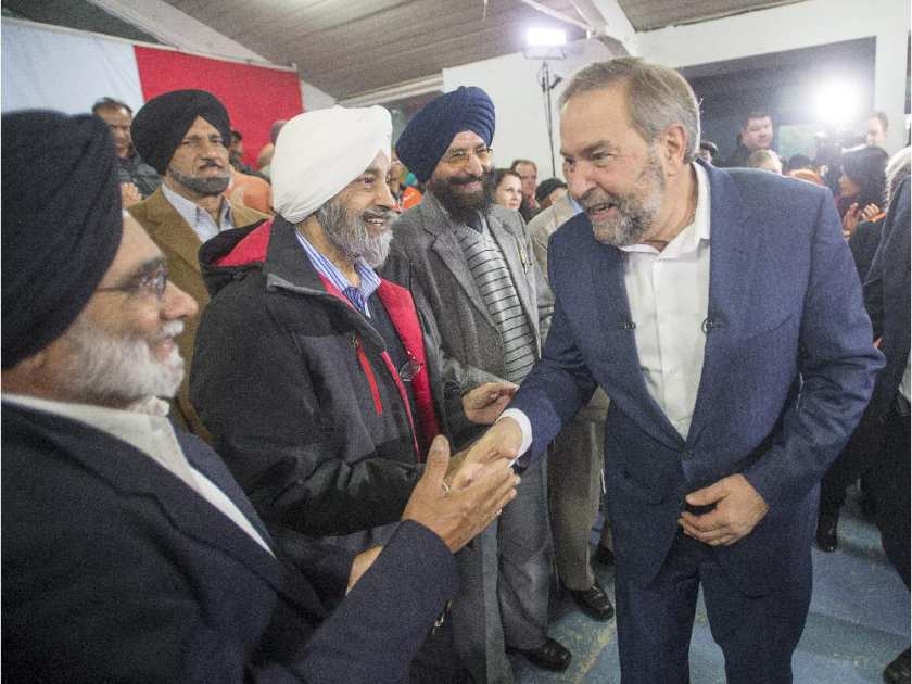NDP Leader Tom Mulcair greets supporters at a town hall meeting Tuesday, October 6, 2015 in Surrey, B.C.